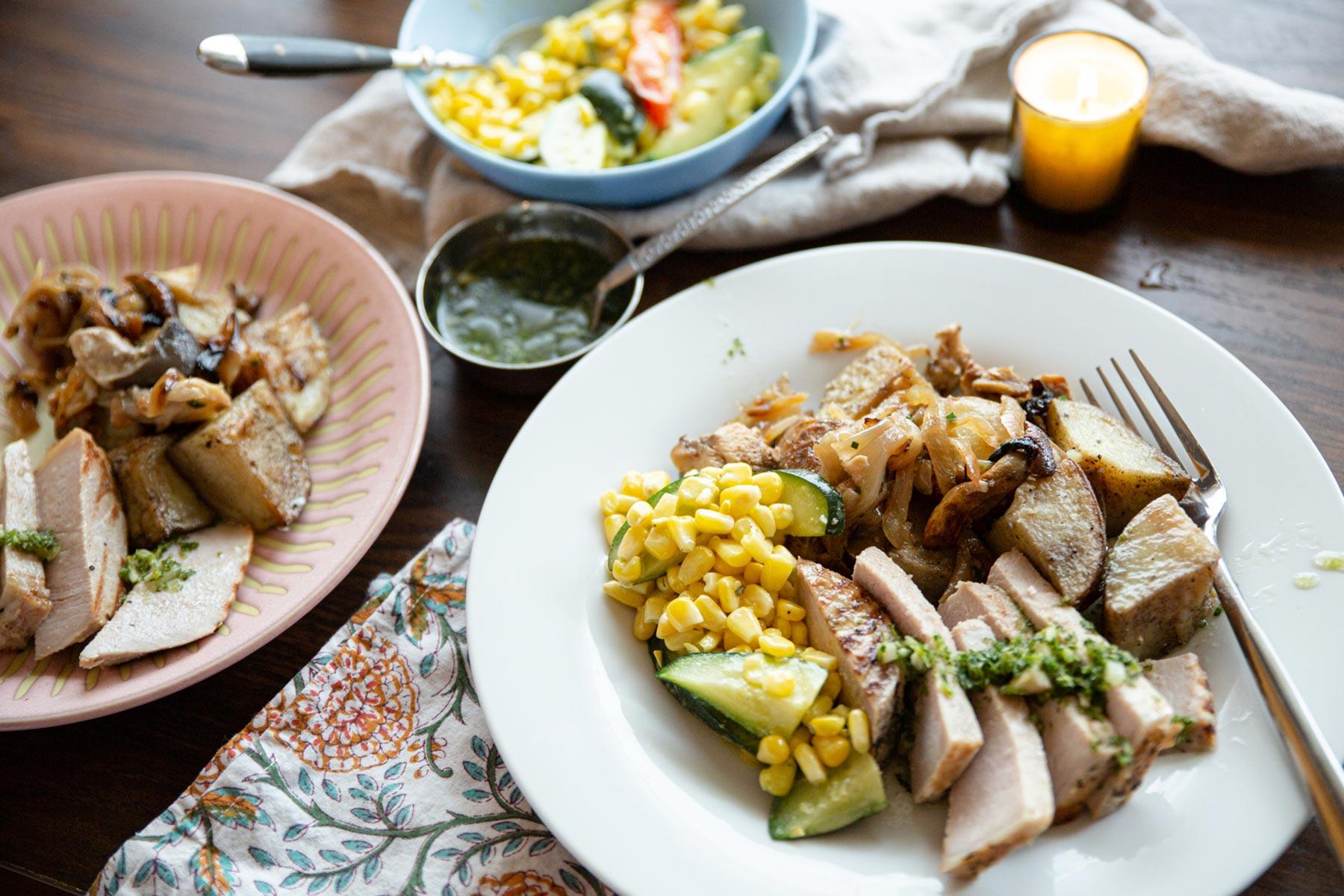 Pork with corn, cucumbers, and potates